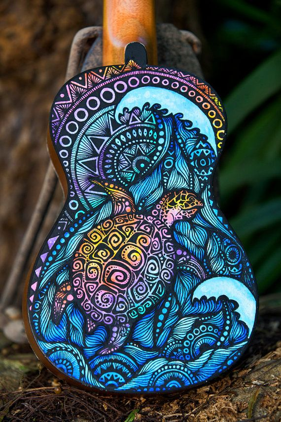 Hand Painted Mahalo brand Ukulele. Both sides are painted in intricate detail with acrylic paint pens. This little ukulele is called the Aurora Borealis Tortoise It is protected with a glossy acrylic top coat so it is durable and hard wearing enough for regular play. It comes with strings. I hope you like it