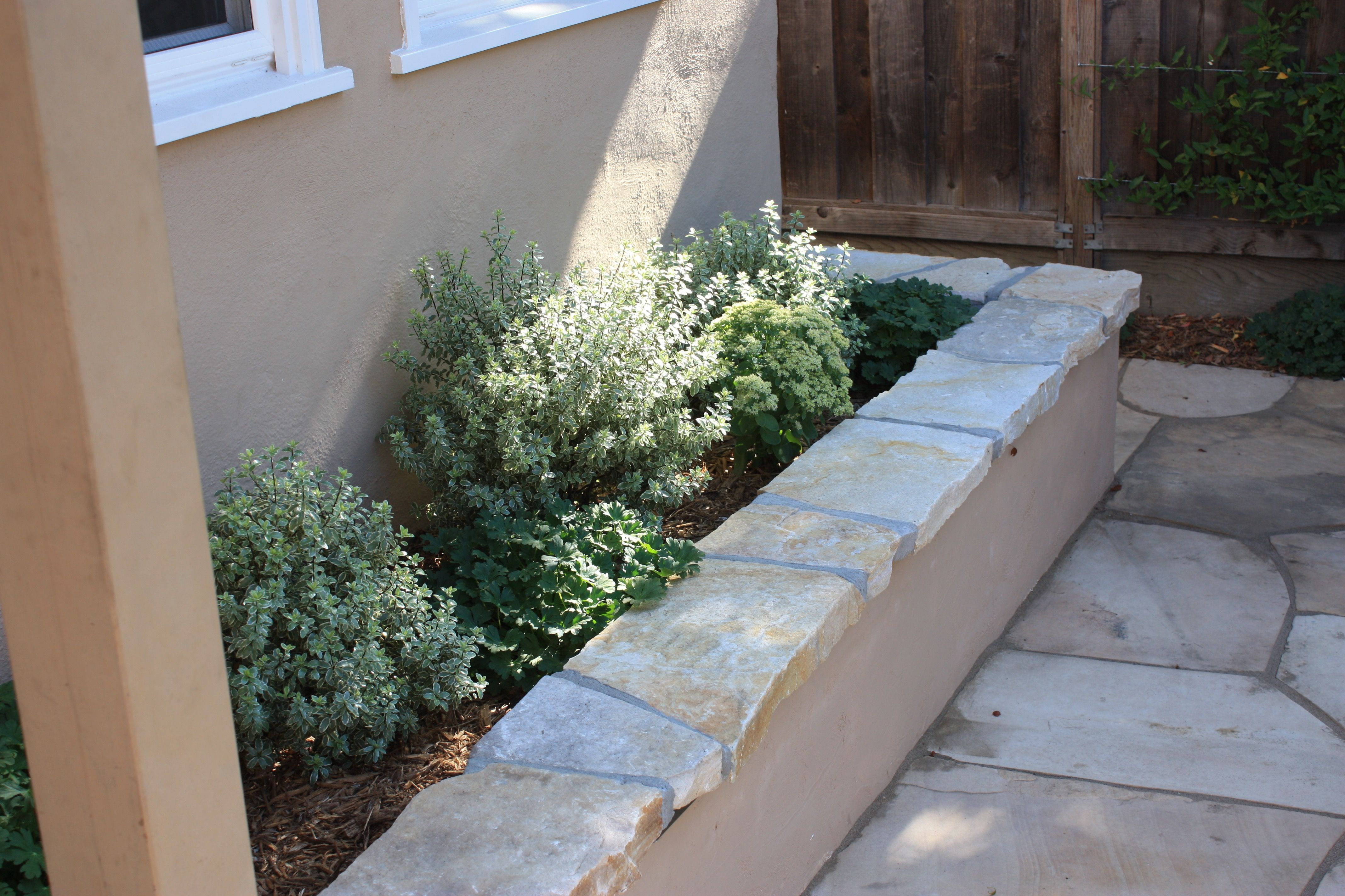 Pin By Erin B On Front Yard In 2020 Stone Retaining Wall Wall Seating Raised Planter Beds