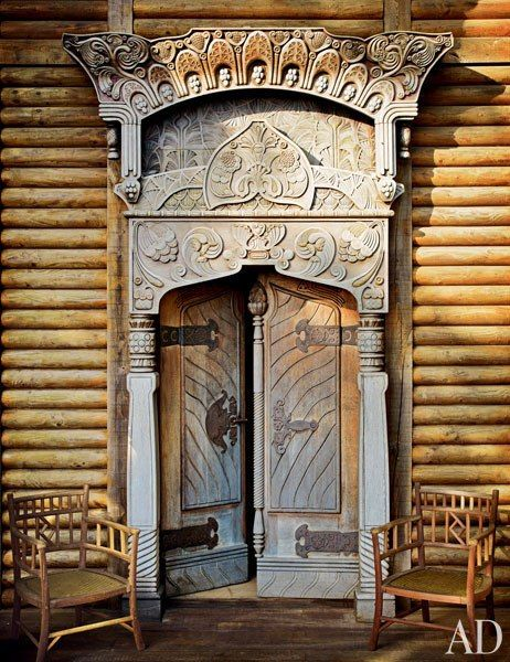 A flamboyantly carved doorcase frames the dacha's main entrance; both it and the doors were made in the late 19th century at Russia's Talashkino workshops.