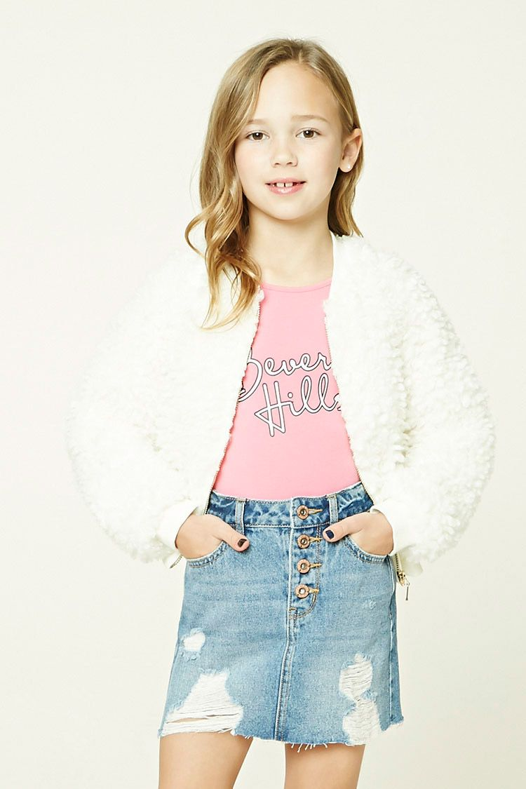 7f6974a54b Forever 21 Girls - A denim skirt featuring a distressed design, raw-cut  hem, a four-pocket construction, and a button fly.