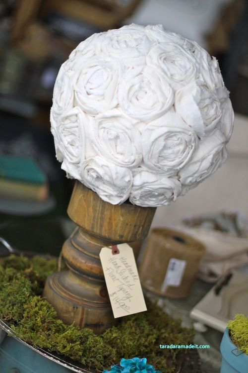Love this! Cover a Styrofoam ball with rosette flowers and glue it to a candlestick.