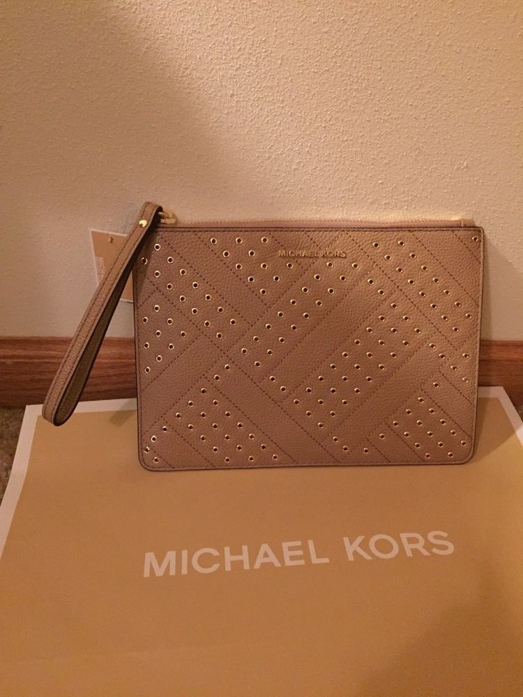 2a1107fa3fa29 Michael Kors Jet set Travel XL Zip Clutch Dark Khaki Leather with Gold  accents.