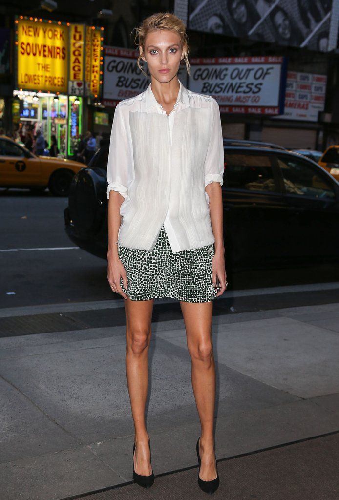 Anja Rubik put her long limbs on display in a printed miniskirt in Poland.               Image Source: Fame...