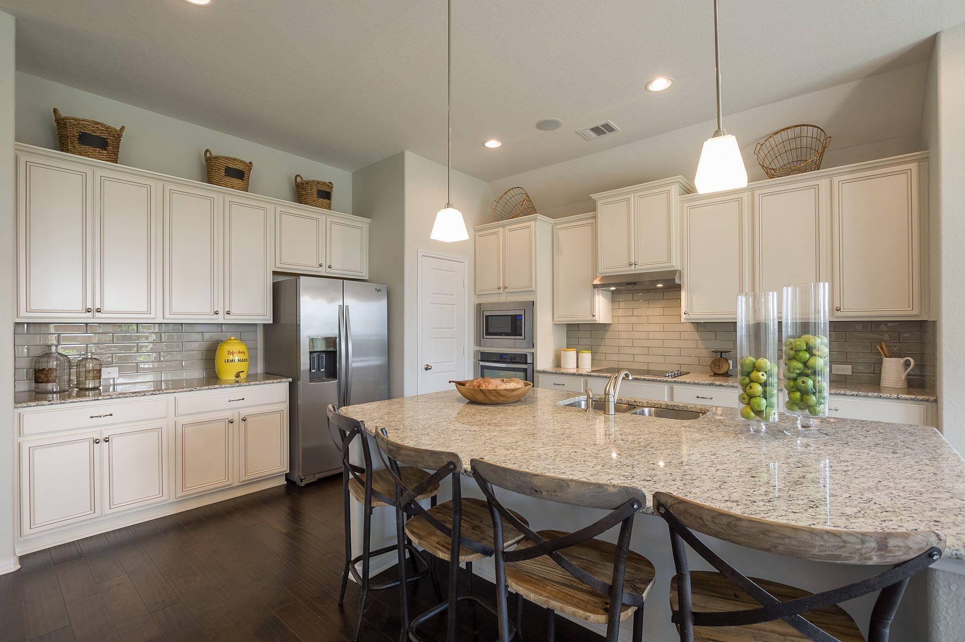 Custom cabinetry, granite countertops, and subway tile backsplash ...