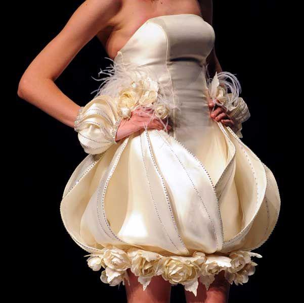 A model presents a creation of Taiwanese designer Tsai Meiyue\'s 2011 ...