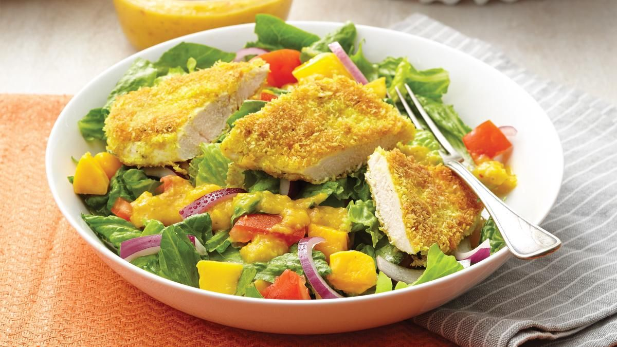 Coconut Curry-Crusted Chicken Salad with Mango Dressing. Crisp salad is topped with a spiced coconut-crusted chicken breast in this salad that's a cinch to put together. The mango dressing is truly heavenly, with a commingling of sweet, tart and spicy notes.