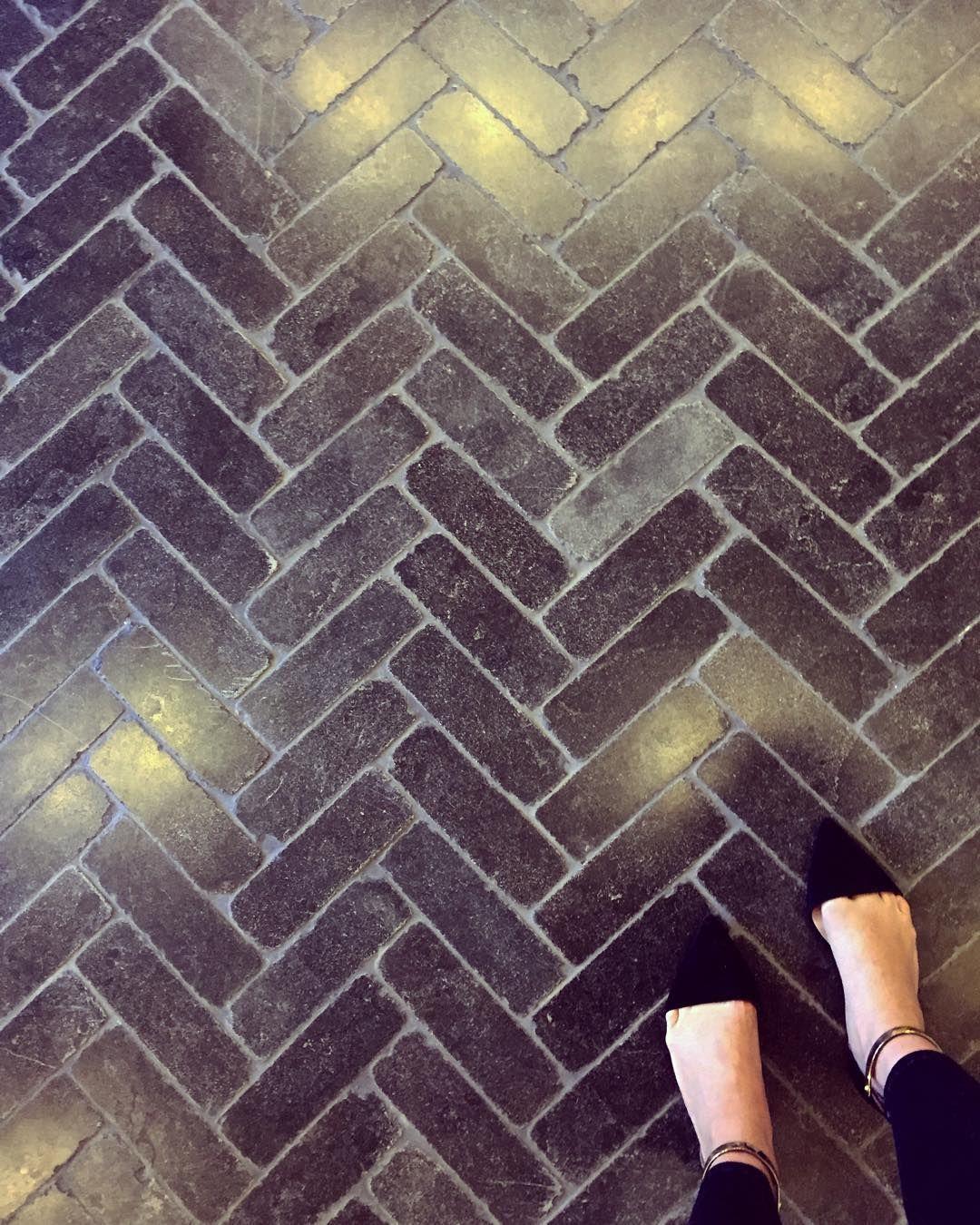 This Tumbled Black Limestone Herringbone Tile Is So So