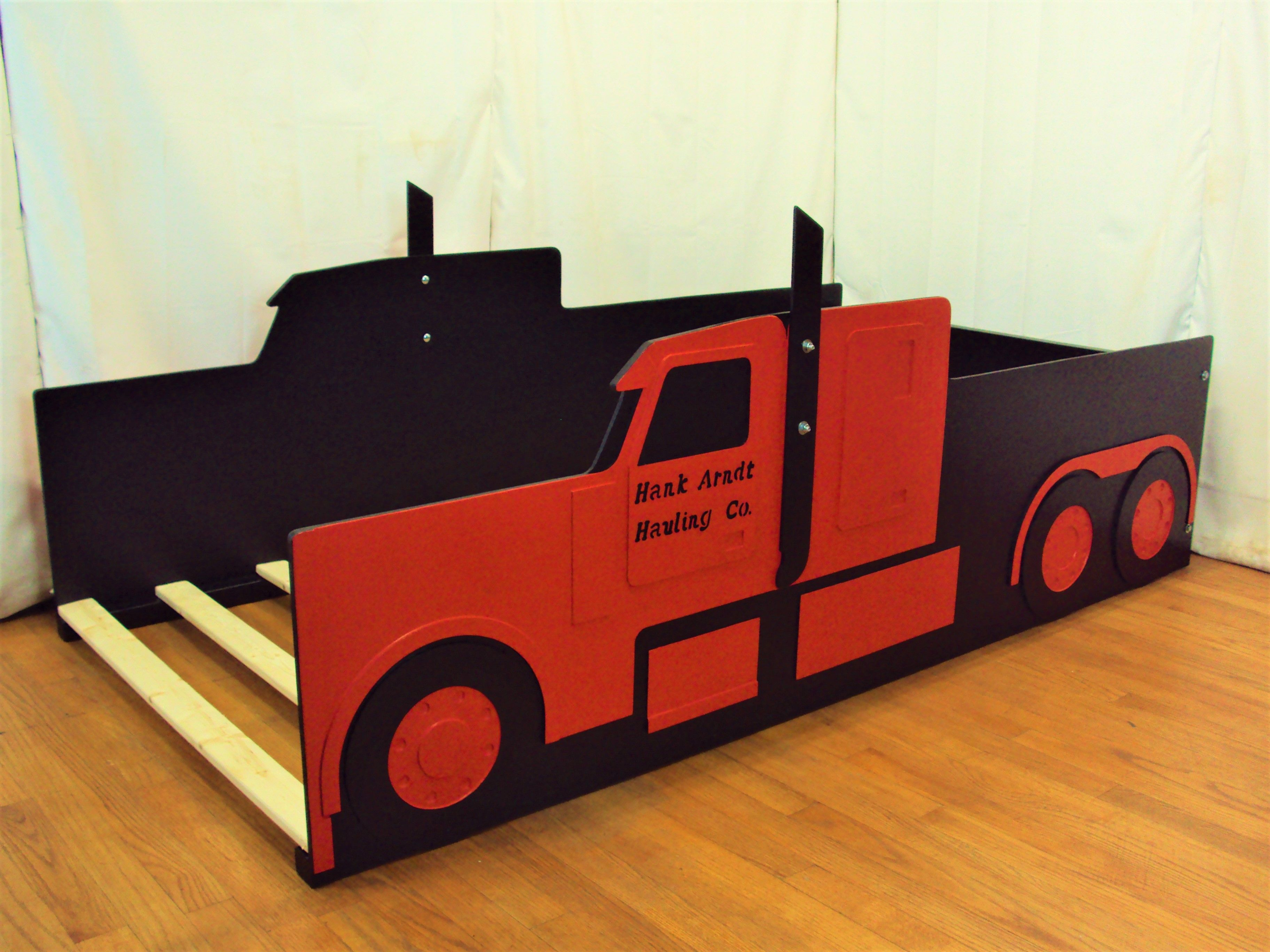Customized red Peterbilt semi truck twin size bed frame