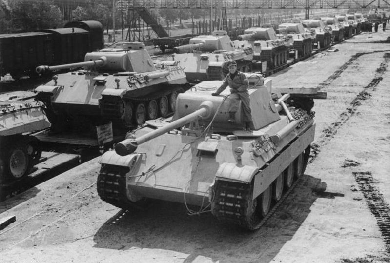 A Panther heavy tank rolls to board a train for transport to the Eastern Front, Summer 1943. Extremely sophisticated for its time, and with a fearfully accurate gun, the Panther ironically suffered because of its own technical complexity: maintaining it and repairing it could be extremely difficult in the field.
