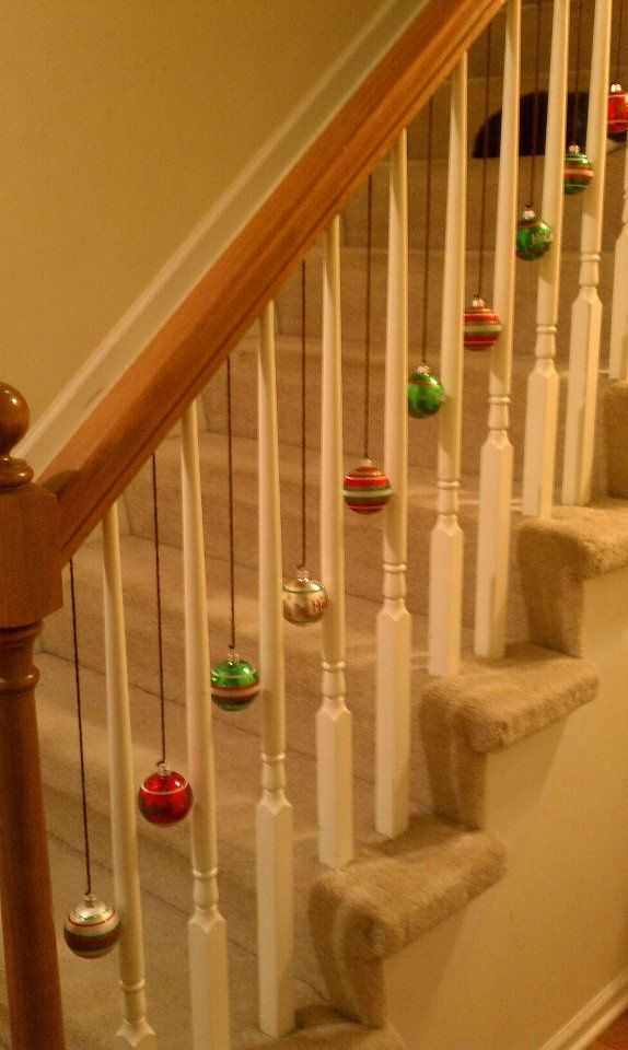 Pin by debby church on holidays christmas stairs - Christmas decorations for stair rail ...
