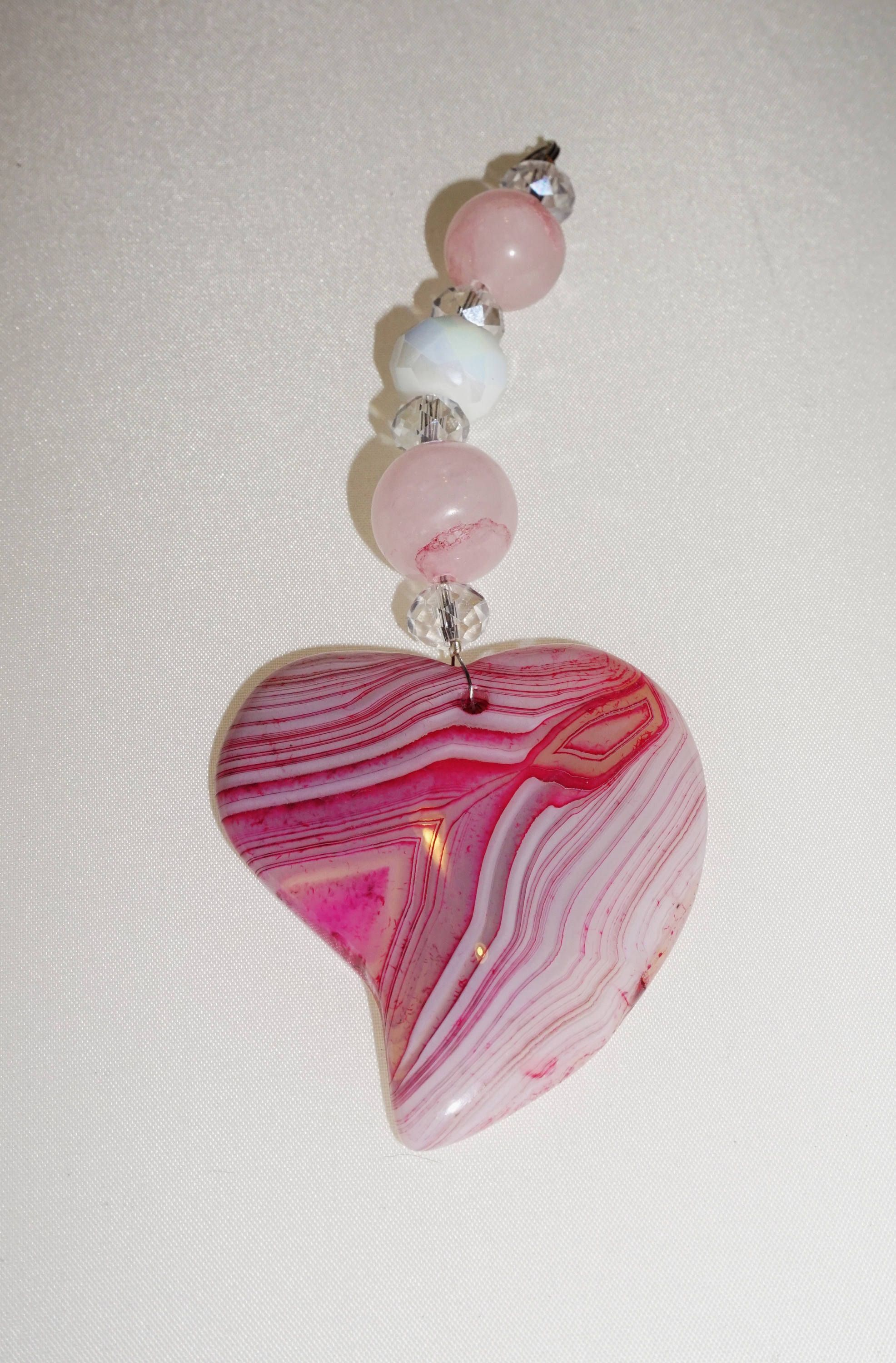 Charm of ornaments from rose quartz