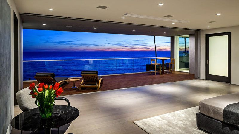 This modern home in Malibu includes plenty of palm trees and ocean on