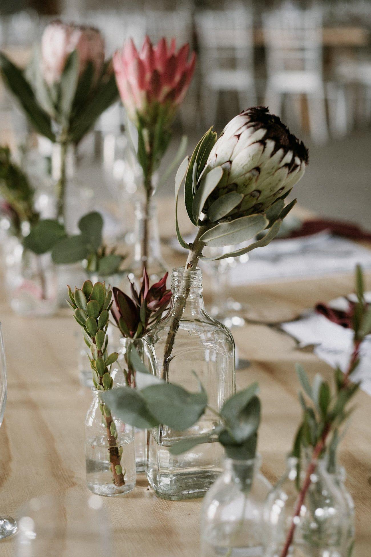 Moody Protea Filled Forest Wedding At De La Mas By Chris De Wet Southbound Bride Wedding Centerpieces Wedding Flower Arrangements Unique Wedding Flowers