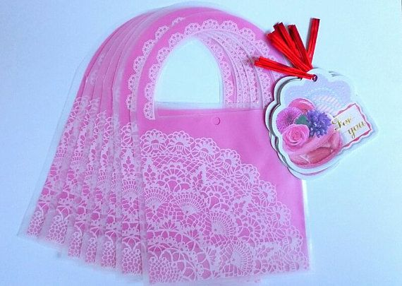 He encontrado este interesante anuncio de Etsy en https://www.etsy.com/es/listing/178722497/pack-of-7-lace-printed-pink-treat-bags