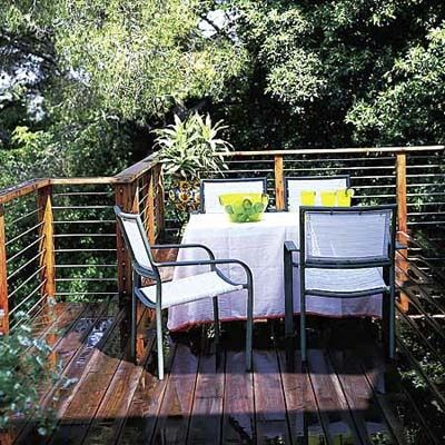 Cable Access Wood And Metal Collaborate In This Decks Unobtrusive Railing Horizontal Tubes Of 1 2 Inch Stainl Outdoor Design Deck Garden Backyard