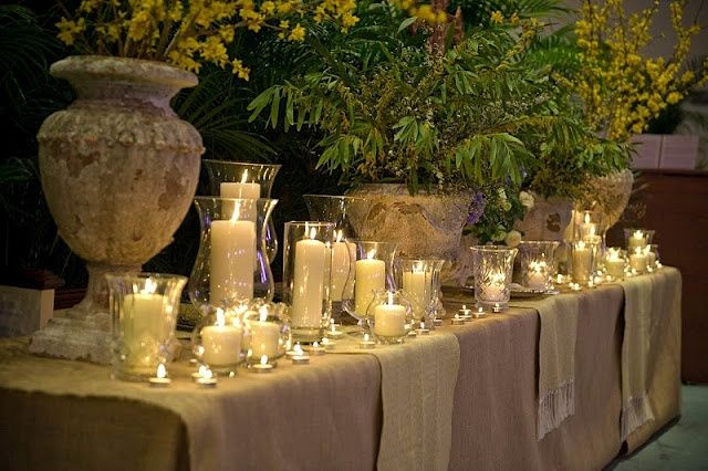 A winter mix of flowers with bare sticks and limbs. Candlelight too adds warmth to the chilly season as well as ambiance.
