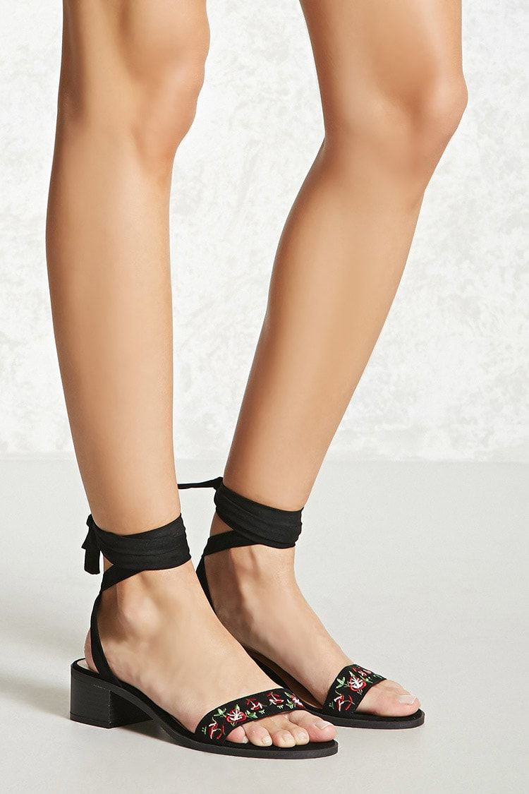 e2467381bcb3 A pair of faux suede sandals featuring an embroidered open toe vamp strap