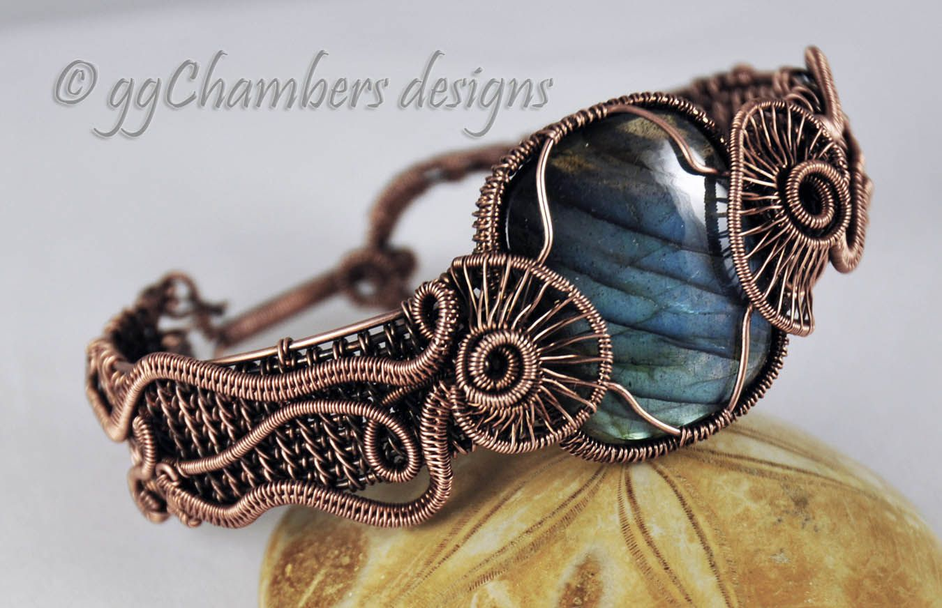 This is a new Wire Helix design for me and I call it the Jellyfish Helix. The helix, on either side of the bracelet, represents the body of a jellyfish, while the long woven wire tentacles stream d...