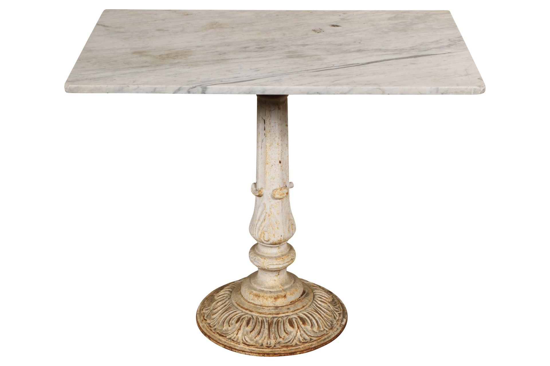 A rectangular gray marble top mounted on an antique cast iron fluted