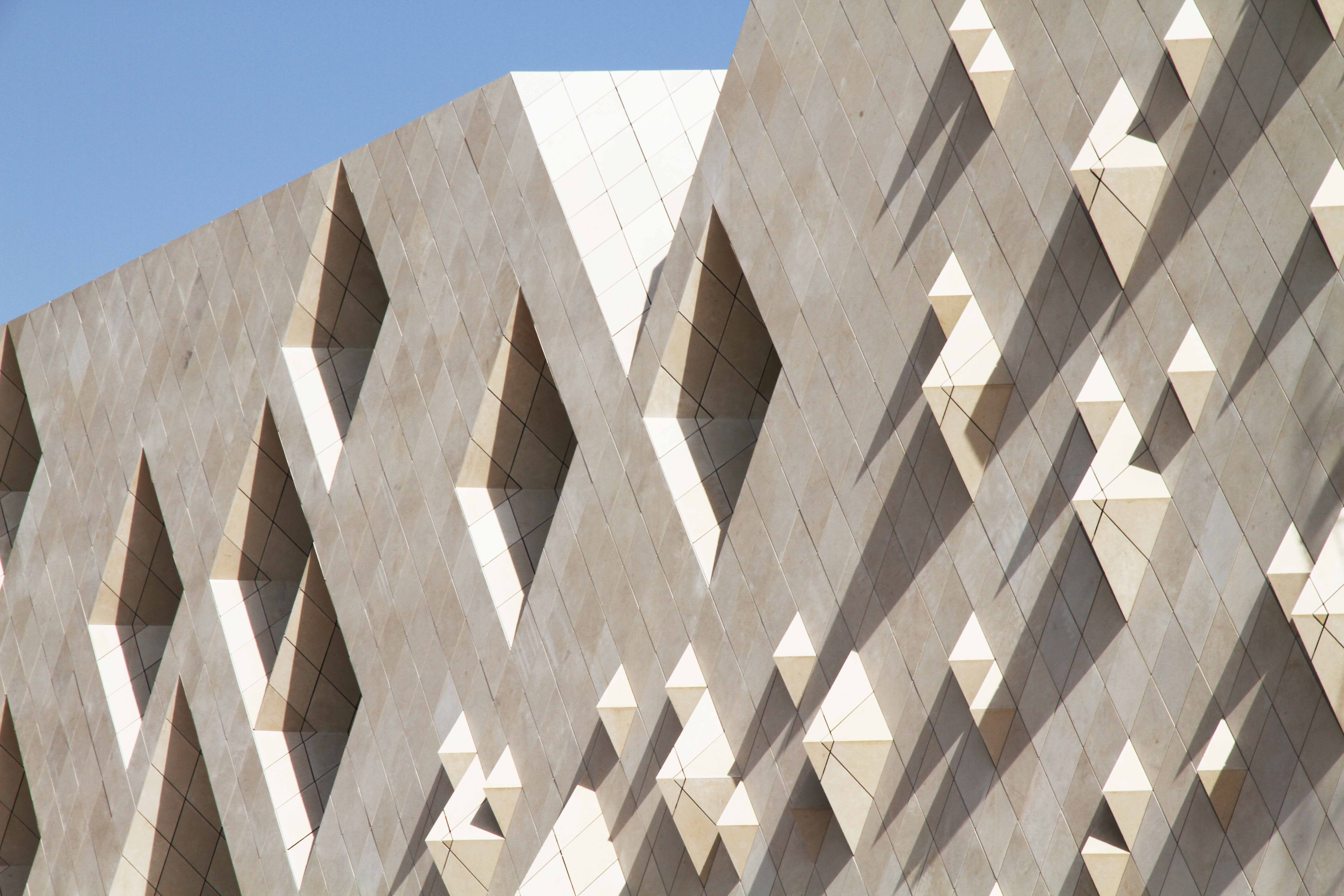 Institute of Diplomatic Studies in Riyadh, Saudi Arabia. Elaborated façades will make the large building vary vividly when passing by, and like looking through a veil one will sense the life and activities within the building. Photo by Marisa Ingvartsen