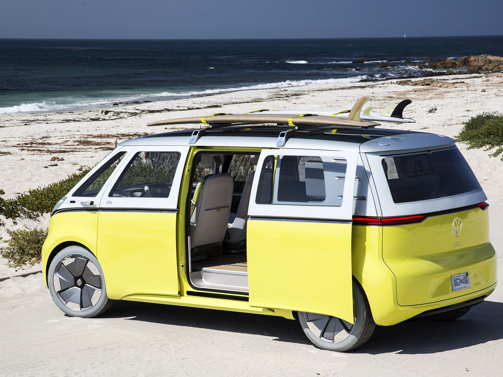 The New Vw Bus Is Back And It S Electric Electric Van Volkswagen Electric Cars