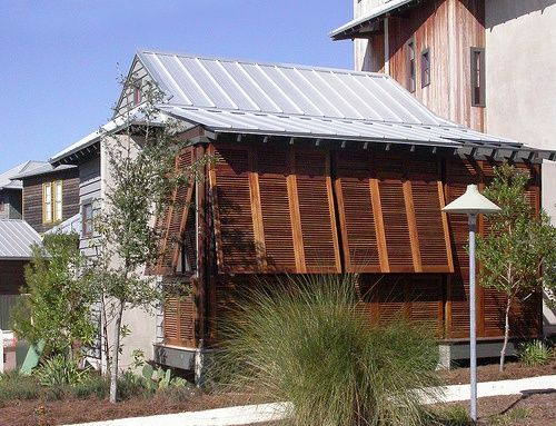 Stained Wood Hurricane Shutters, Weathered Wood Times, Metal Roof, And  Landscape Plants.