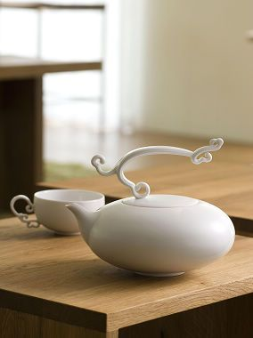 very cool pot & cup handles. Beautiful, but I wouldn't trust myself with not breaking that top ornament off.