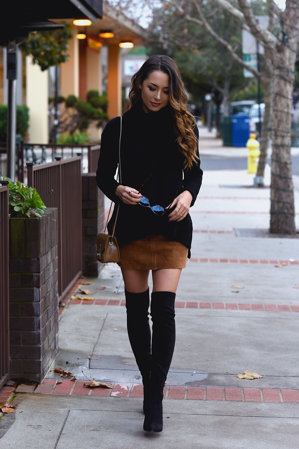 b66ce17dfad Black sweater over tan suede mini skirt with black OTK boots ...