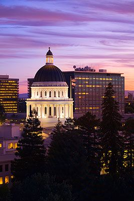 The California State Capitol building in downtown Sacramento at sunset.
