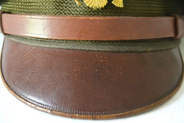 """07078ff8a5f46b WWII Bancroft """"Flighter"""" crusher cap. This peaked cap features a gold tone  WWII Army Overseas insignia over a leather visor. The top of the hat is ..."""
