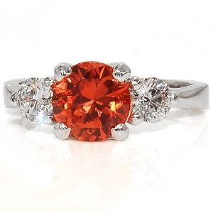 Orange sapphire ring with diamonds. Just too beautiful from knoxjewelers.biz