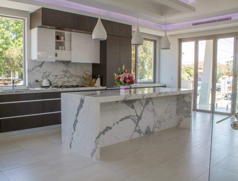 Statuario marble used for kitchen island. Fabricated and installed ...