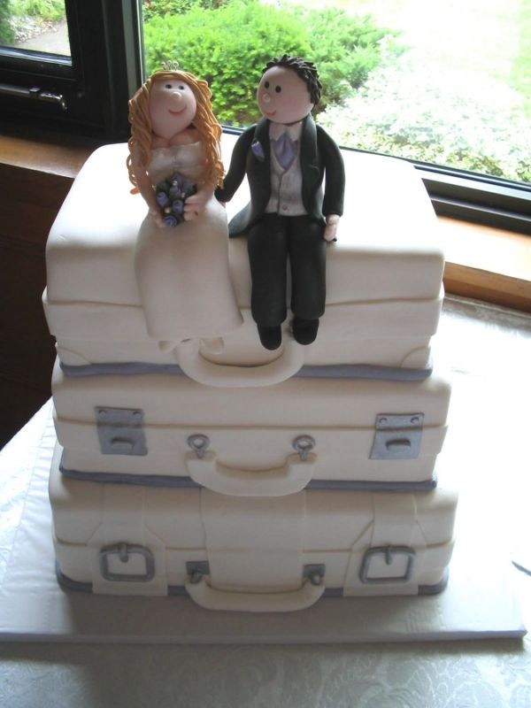 Suitcase wedding cake with fondant bride and groom topper