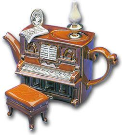 Piano Teapot.Teapots are whimiscal.  It is always important to laugh and have a sense of humor.