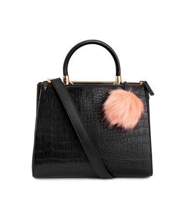acb9c917f Handbag in grained imitation leather with a faux fur pompom. Three  compartments, two with zip. Handle and detachable shoulder strap. Size 4 1/2  x 8 3