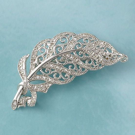 The winsome form of a leaf in the wind is a classic vintage motif. Sterling silver filigree adorned with .15 ct. t.w. diamonds. Revolver safety, sterling silver pin/pendant.