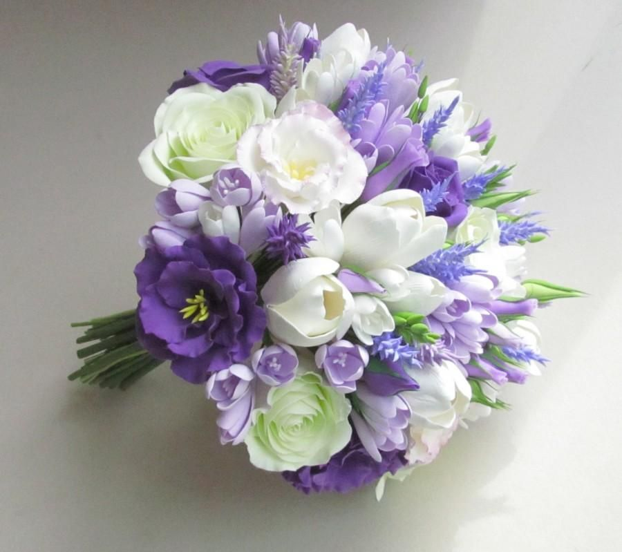 White tulip, baby's breath, and wax flower bridal bouquet ...