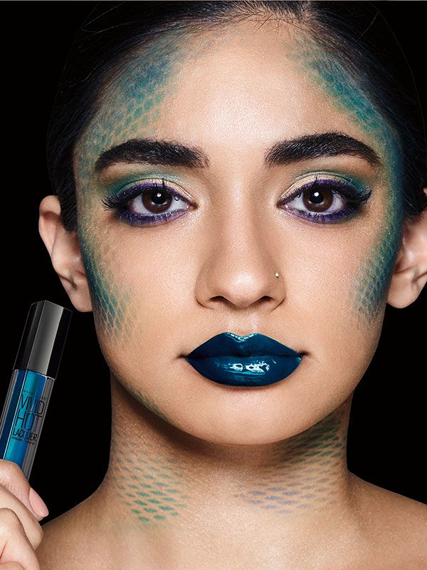 Learn How To Do A Mermaid Scales Makeup Look With Metallic Blue Lipstick Gold Eyeshadow Purpl Dragon Makeup Mermaid Makeup Tutorial Mermaid Makeup Halloween