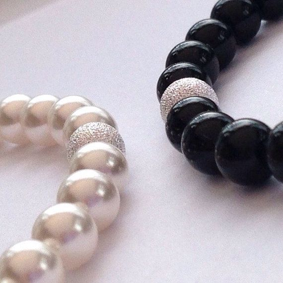 Black and white Swarovski pearls with frosted Sterling silver beads.  These two bracelets are made with 6mm Swarovski crystal pearls. Each one has a