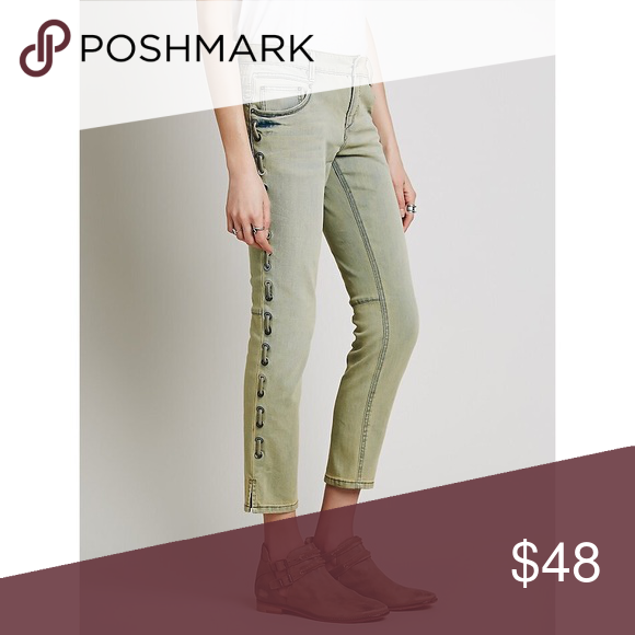 Free People Lost Love Lace-up Skinny Free People Lost Love Lace-up Skinny in North Country Wash  Washed denim skinny jeans with a classic five-pocket design and zip-fly with button closure. Tonal denim-laced sides with grommet hardware. 71% Cotton. 28% Polyester. 1% Spandex. Machine Wash Cold. Never been worn Free People Jeans