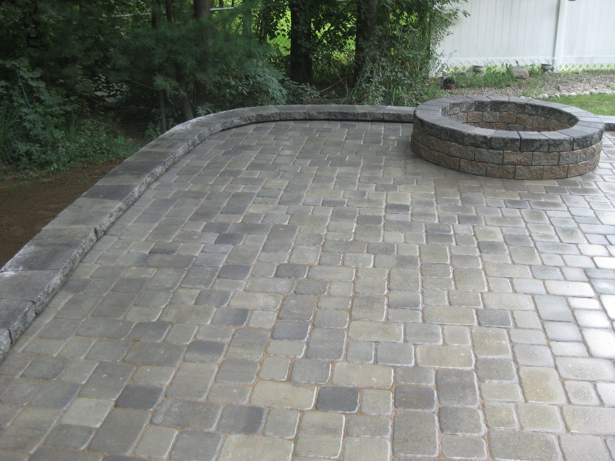 Beautiful Belgard Patio with a Fire pit We raised the patio due