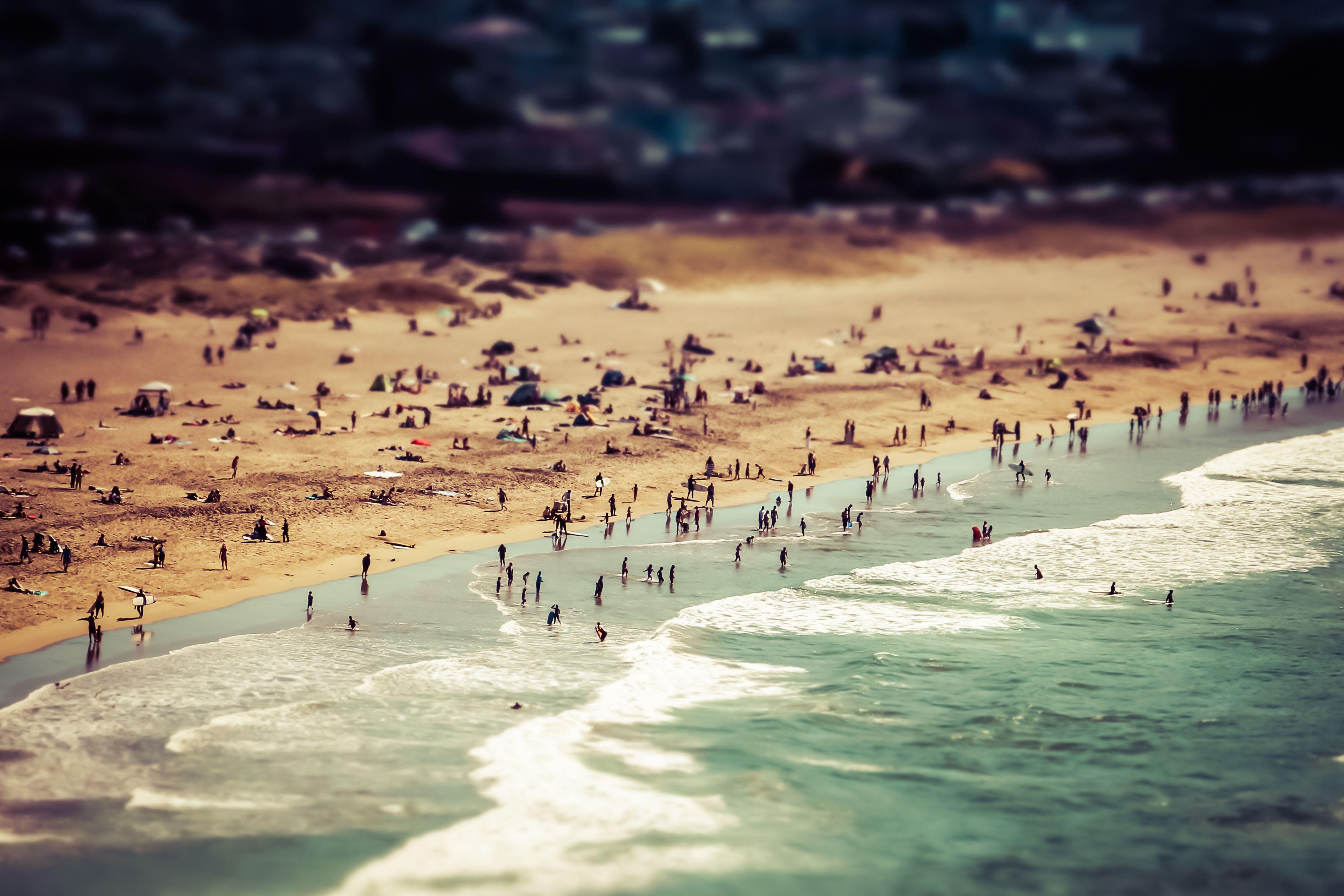 tilt shift scene ocean and surfers at pacifica beach california