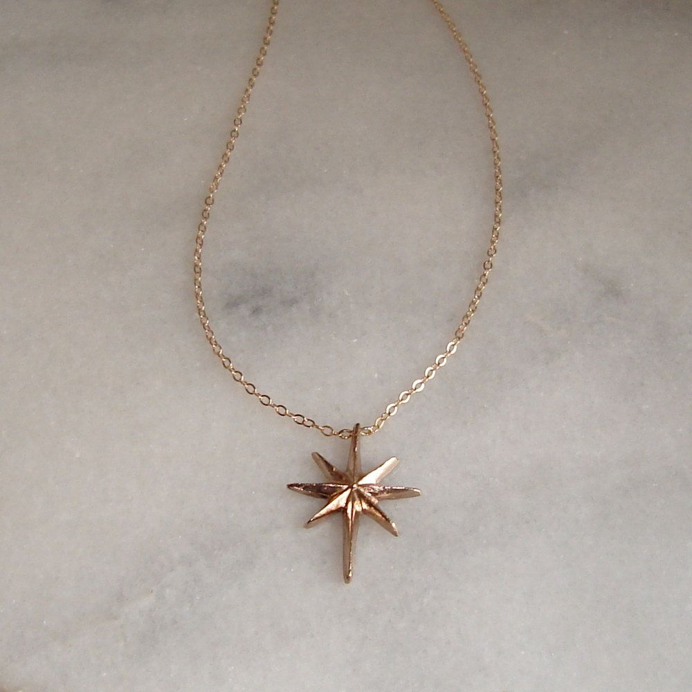 North Star Necklace - Solid Bronze Pendant, Gold Chain. $34.00, via Etsy.