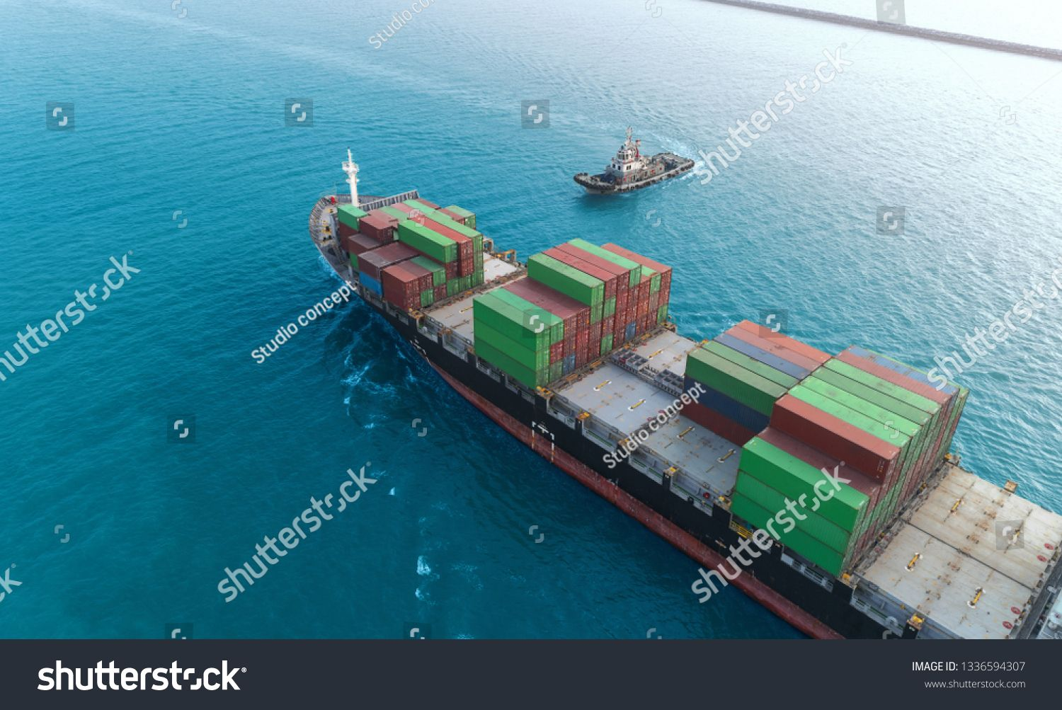 Aerial view Tug Boat come for drag Container ship to Crane bridge at seaport for unload Container to Container warehouse at blue sea. Logistics business, import export, shipping or transportation. #Sponsored , #affiliate, #ship#Container#Crane#seaport