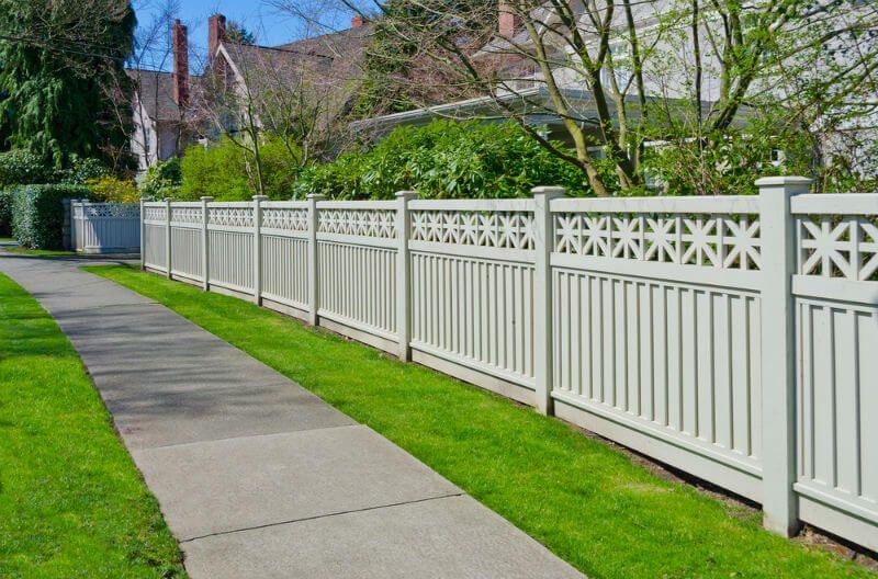 vinyl fence along sidewalk   fence/wall inspiration