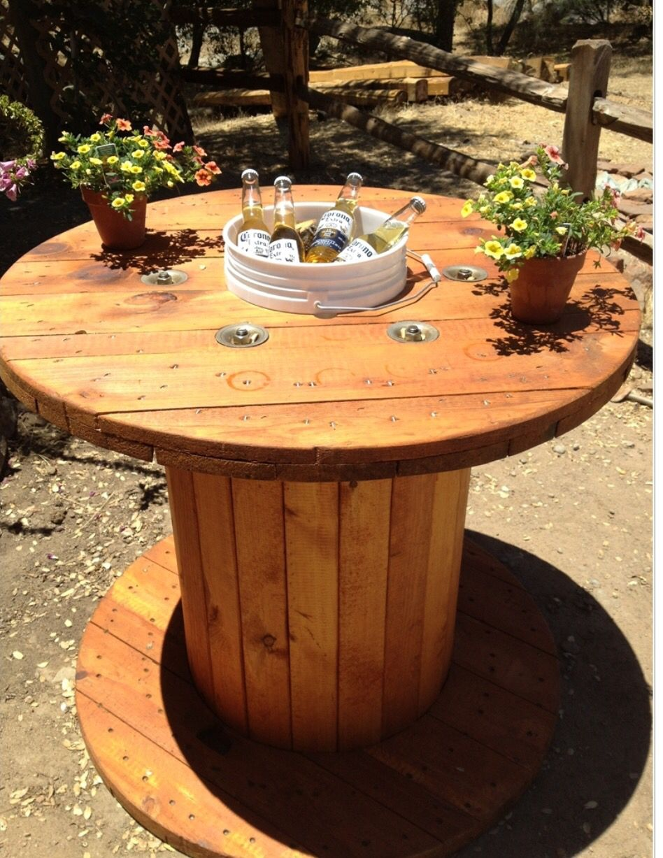 What A Great Idea   Wooden Spool Table. Sanded And Stained The Spool. Cut A  Hole In The Middle And Dropped In A Paint Bucket As A Beer Cooler!