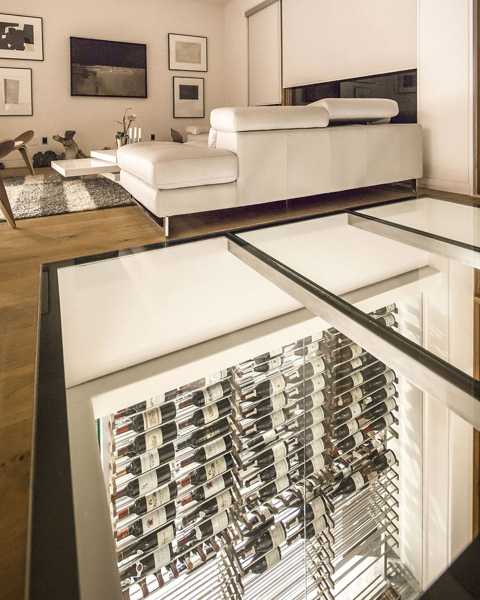 Custom modern glass surround wine cellar designed and constructed by ...