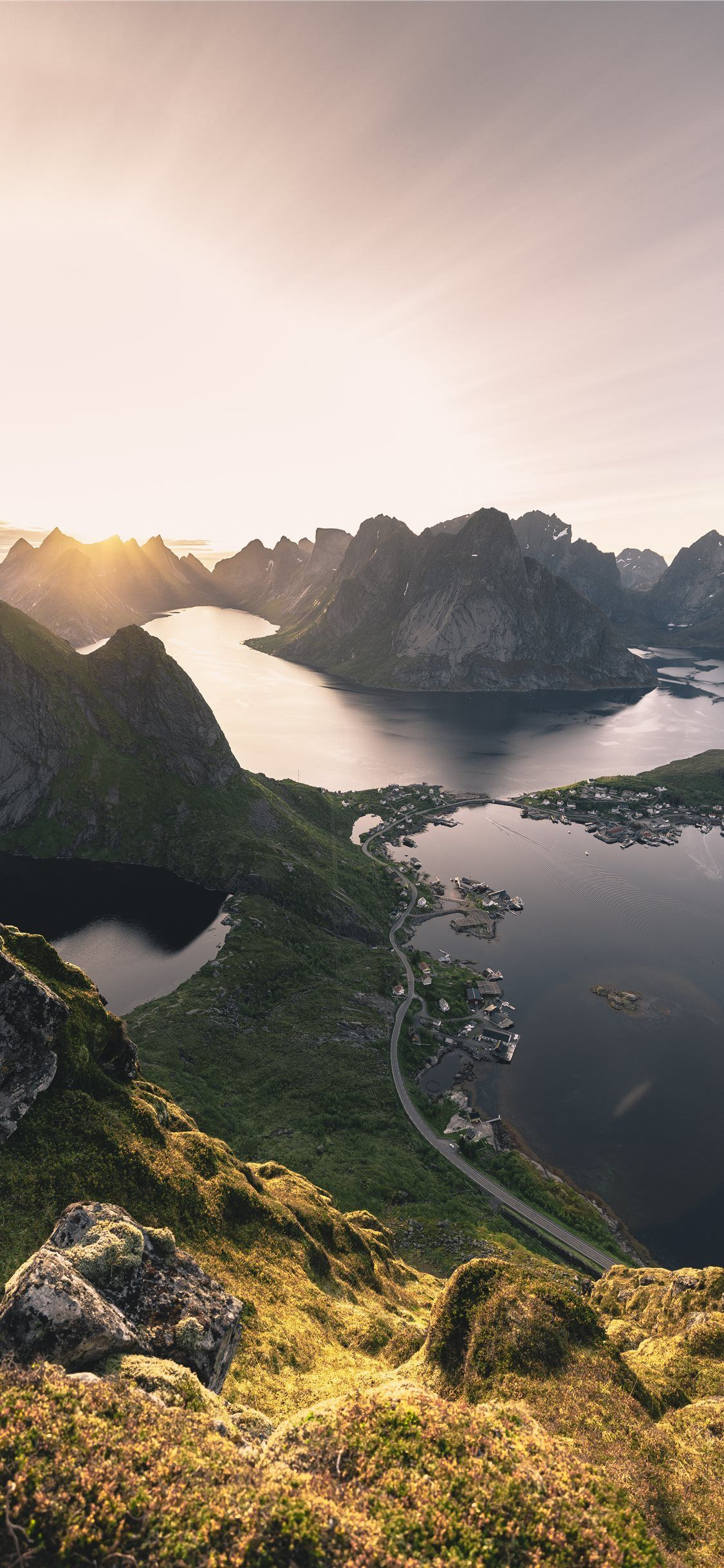 aerial photo of mountains surrounded with body of ... Wallpaper