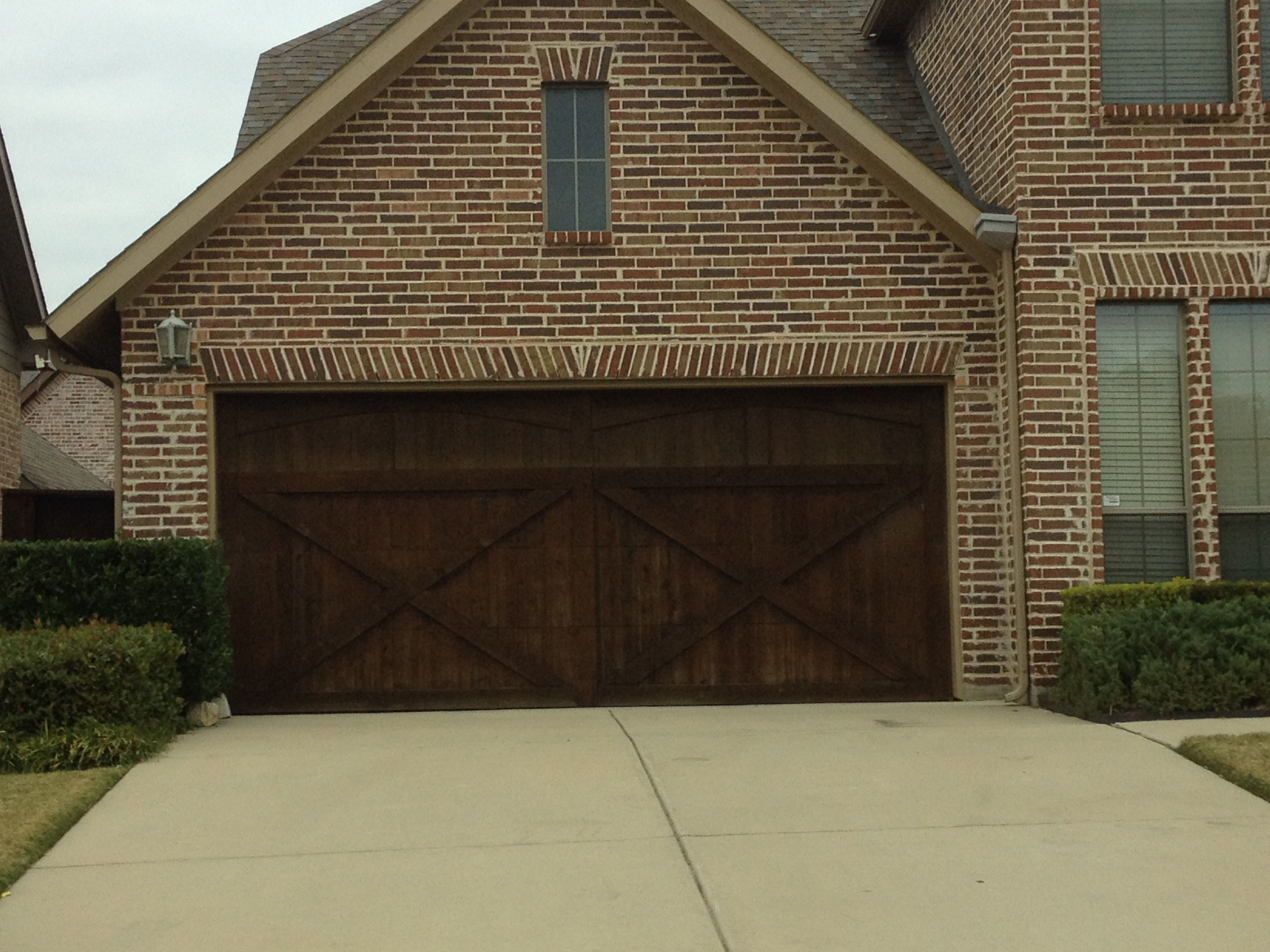 Wood double car garage door brick homes with curb appeal for Two door garage