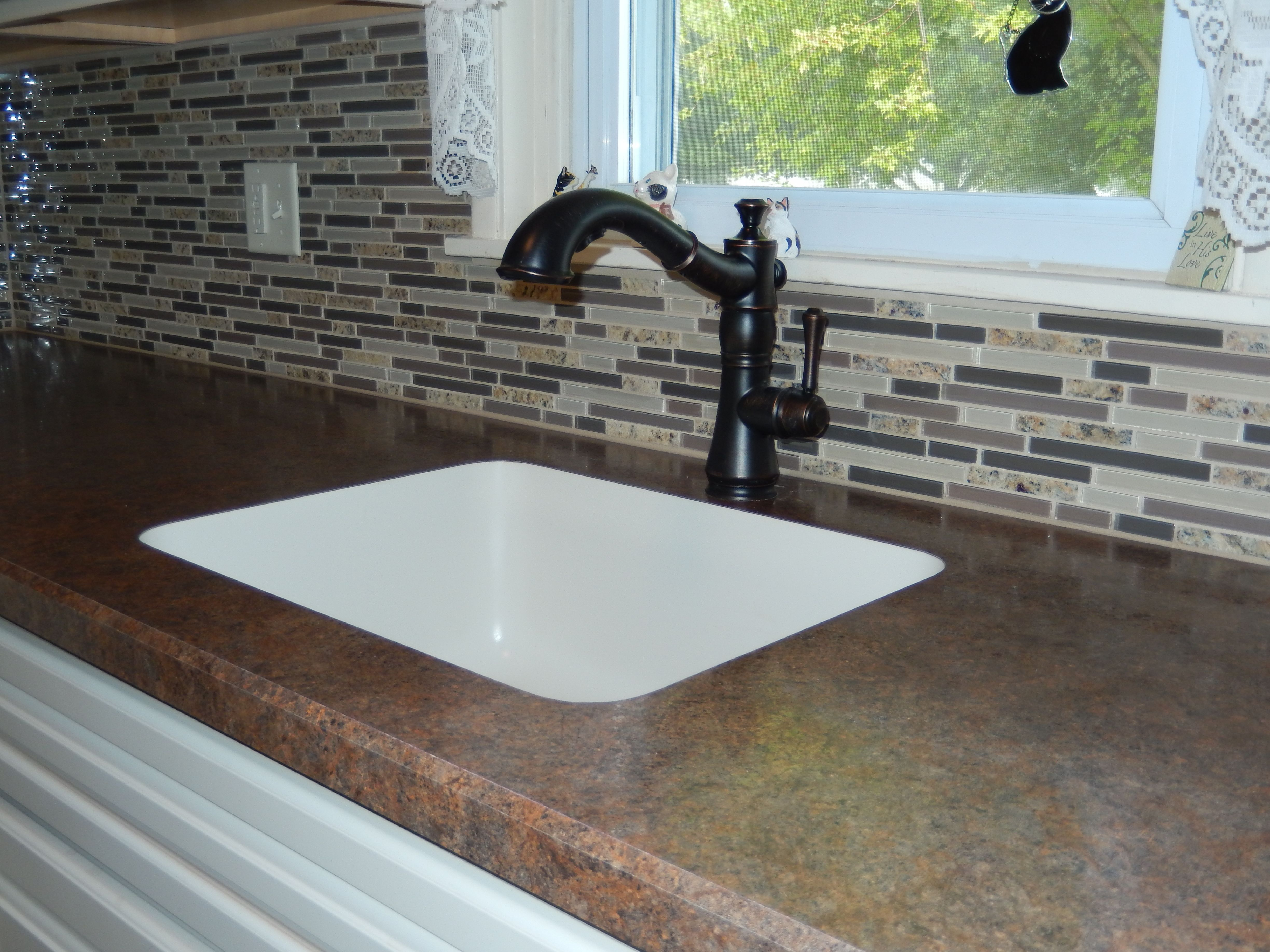 Wilsonart Laminate Counters, Karran Undermount Sink, Oil Rubbed Bronze  Faucet, Linear Mosaic Tiles